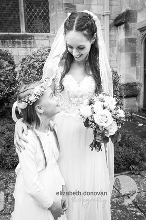 sweet bride and her bridesmaid looking at each other elizabeth donovan photography  wiltshire