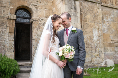 bride and groom share a moment outside church elizabeth donovan photography  wiltshire